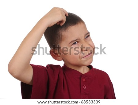 Boy scratching head confused, eight years old, isolated on pure white background - stock photo