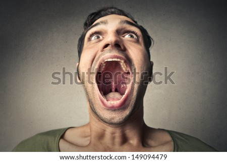 boy screams opening the mouth - stock photo