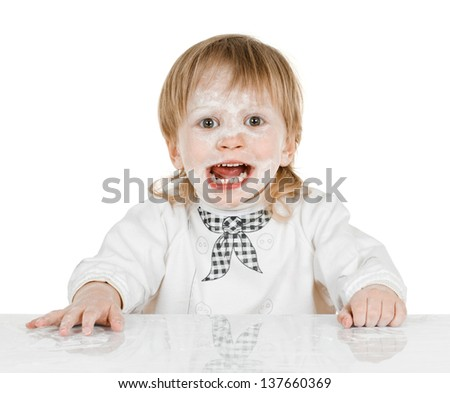 boy scullion with flour on his face - stock photo