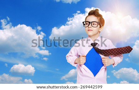 boy secret super hero on blue sky background - stock photo