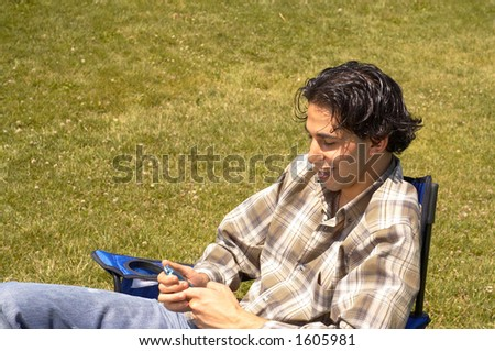 boy sending sms - stock photo