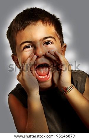 Boy shouts it out loud - high contrast effect - stock photo