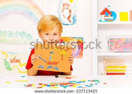 Boy show picture made with nails and blocks - stock photo