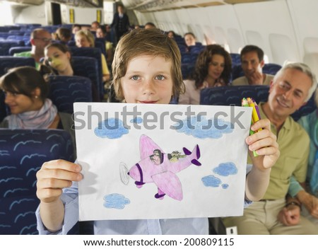 Boy showing airplane drawing on airplane