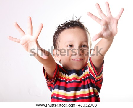 Boy showing his hands in front and smiling