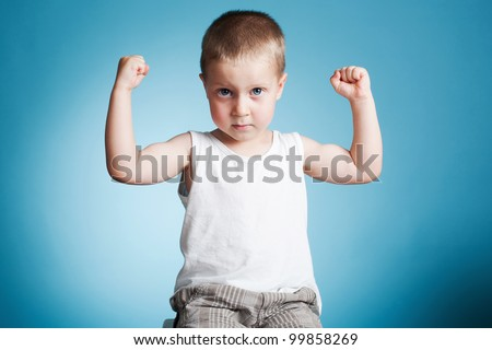 Boy showing his muscles - stock photo