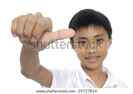 Boy showing thumb up sign - stock photo