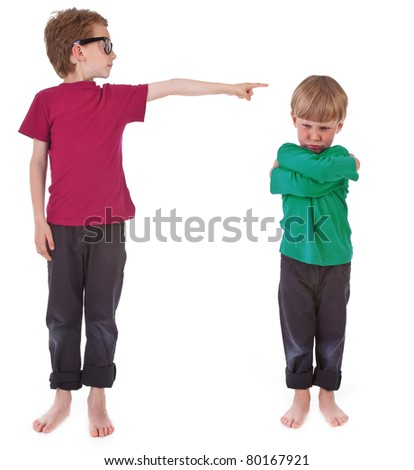 boy showing who is guilty on white background - stock photo