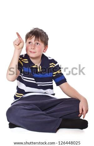 boy shows his finger on a white background - stock photo
