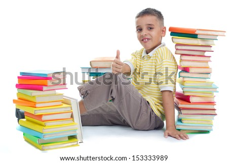 boy siting on floor surrrounded with books