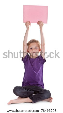 boy sitting and holding a blank page with copyspace for your text - stock photo