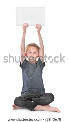 boy sitting and holding a blank white page with copyspace for your text - stock photo