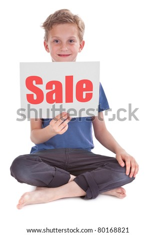 boy sitting and holding white page with sale word - stock photo