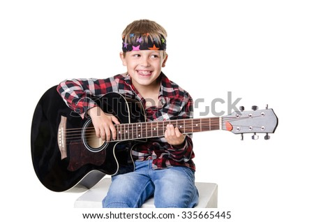 boy sitting and playing on guitar isolated on  white background - stock photo