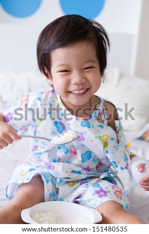 boy Sitting At Home Eating Meal Smiling At Camera in hospital - stock photo