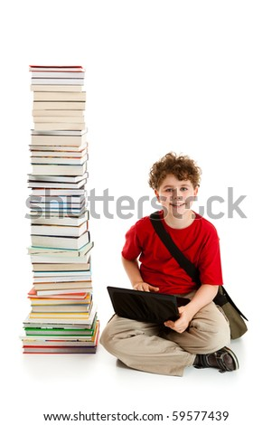 Boy sitting close to pile of books isolated on white background - stock photo