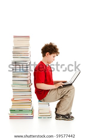 Boy sitting close to pile of books isolated on white background