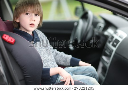 Boy sitting in the front car seat