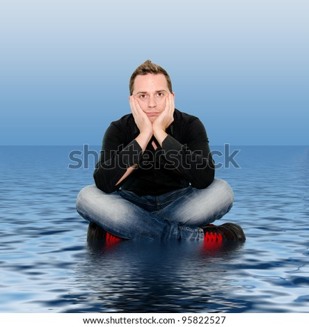 boy sitting on the water - stock photo