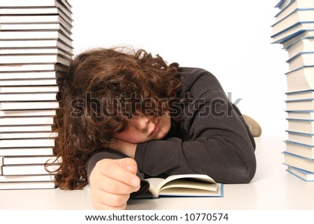 boy sleeping and and many books on white background - stock photo