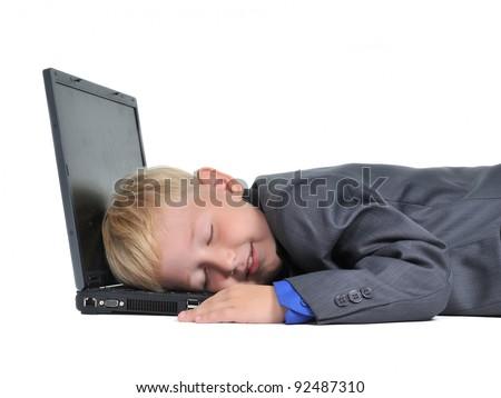 Boy sleeping on laptop tired of work, isolated on white - stock photo