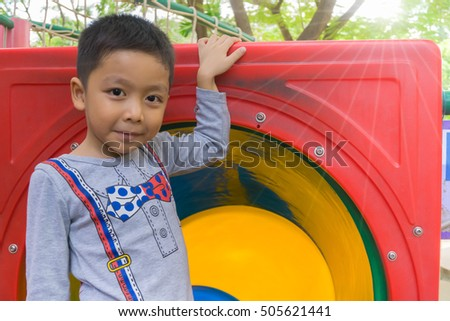 Boy slides down a spiral slide