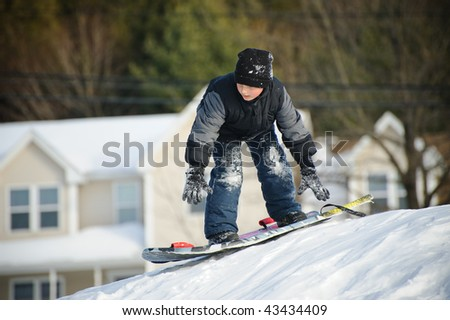 Boy sliding down hill - stock photo