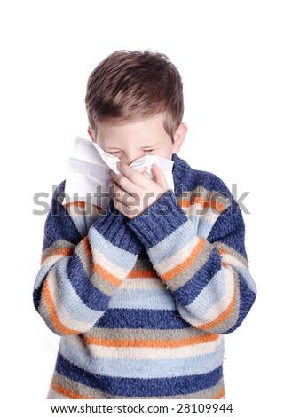 Boy sneezing in his handkerchief - stock photo