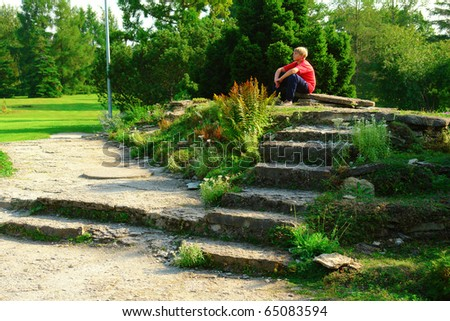 Boy spending time in the autumn park - stock photo