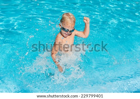 boy splashing in the water
