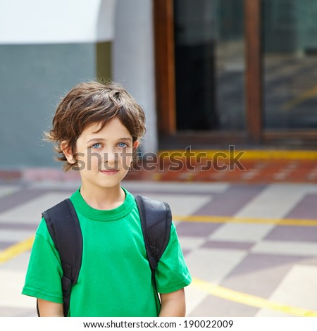 Boy standing on schoolyard in an elementary school
