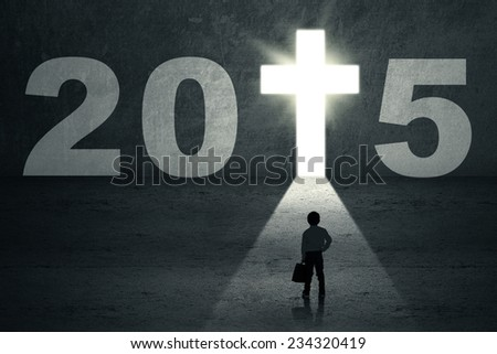 Boy standing on the way and looking at a future door with number 2015 - stock photo