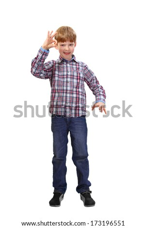 Boy stands and show okay sign isolated on white background