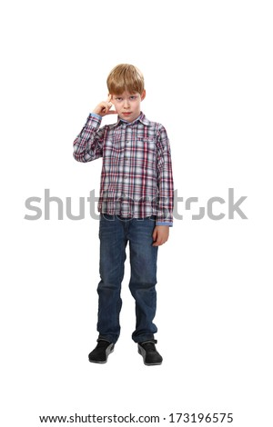 Boy stands thinking isolated on white background