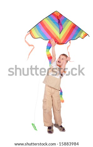 boy starts kite - stock photo