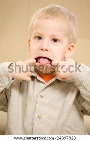Boy sticking out tongue with a funny face