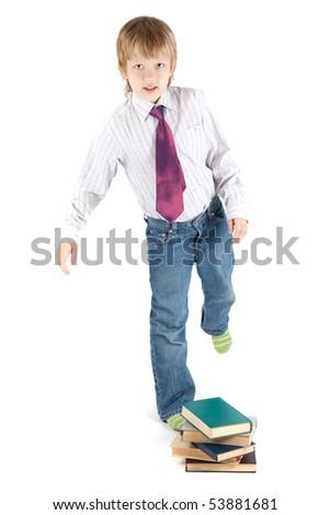 boy strikes books - stock photo