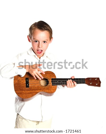 Boy strumming ukulele - high key image