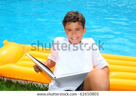 boy student teen vacation homework pool float smiling - stock photo