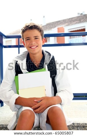 boy student teenager backpack holding books at home outdoor smiling - stock photo