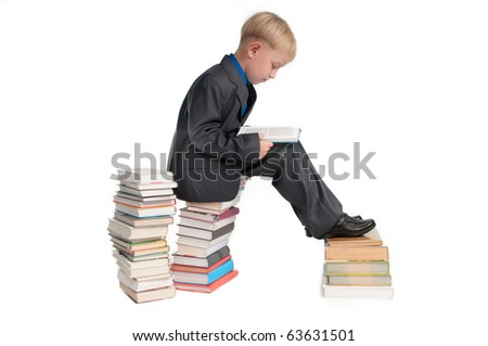 Boy studying his lessons while sitting on a pile of books