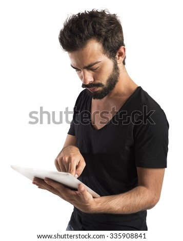 Boy surf the Internet with the tablet - stock photo