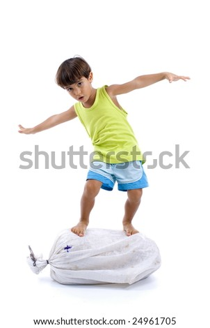 Boy surfing on top of a sack . - stock photo