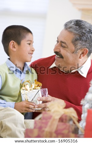 Boy Surprising Grandfather With Christmas Present