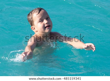 Boy swims in the water park