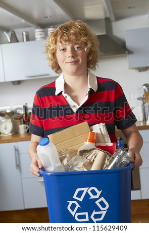 Boy Taking Out Recycling - stock photo