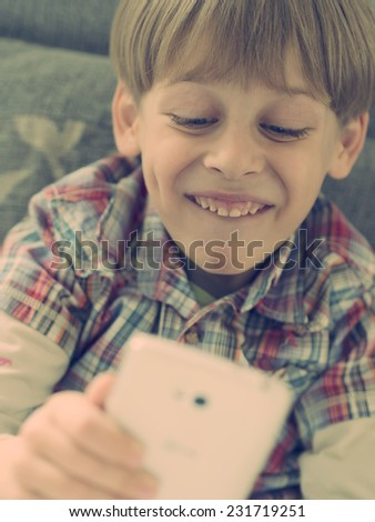 boy taking selfie with smart phone - stock photo