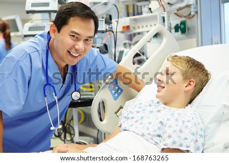 Boy Talking To Male Nurse In Emergency Room - stock photo