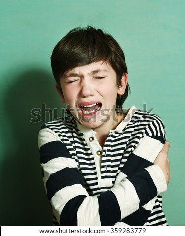 boy teen crying have nervous emotional  break upset feel pain offended abused lonely - stock photo