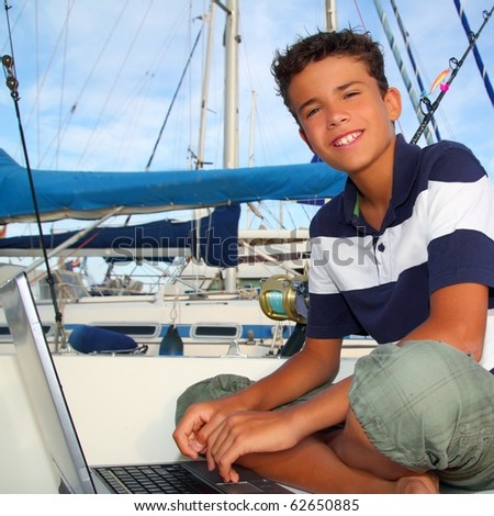 boy teen seat on boat marina laptop computer summer vacation - stock photo